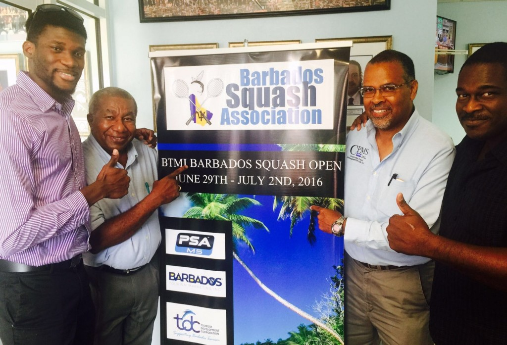 BSA President, Monty Cumberbatch (2nd from left) points to BTMI Barbados Open banner, flanked by National Champion, Shawn Simpson (l), Craig Archer, and Tournament Director, Terry Millar (r).