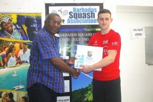 BSA President, Monty Cumberbatch, congratulating 2016 BTMI B'dos Squash Open champion, Joe Green (r), on his maiden PSA tour title.