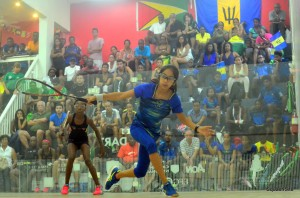 Sumairaa Suleman (in blue) places this backhand with precision against Aboside Cadogan (GUY) on her way to a hard fought 3-0 victory for Barbados in the U-13 division.