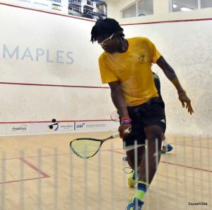 Shemane executes a delicate backhand flick to stay in the rally